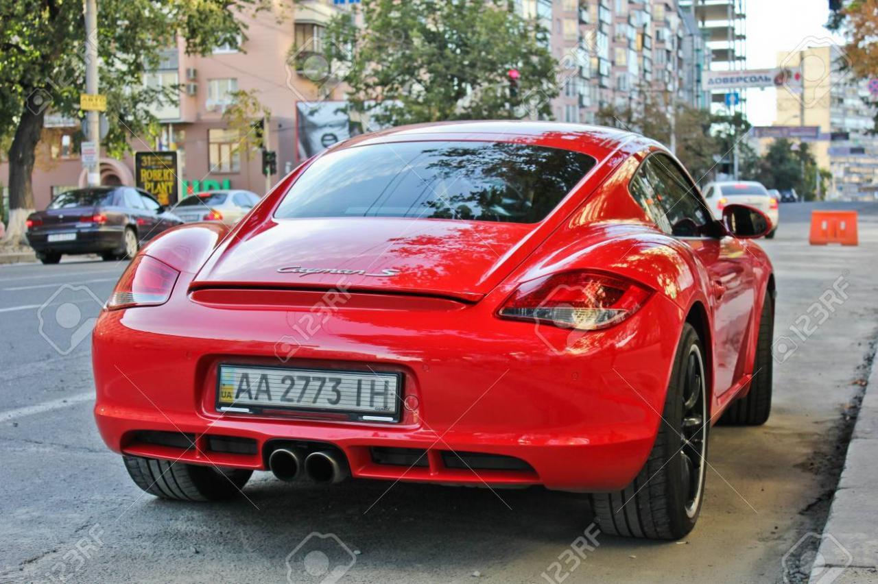88517995-july-3-2013-kiev-ukraine-porsche-cayman-s-red-editorial-photo-